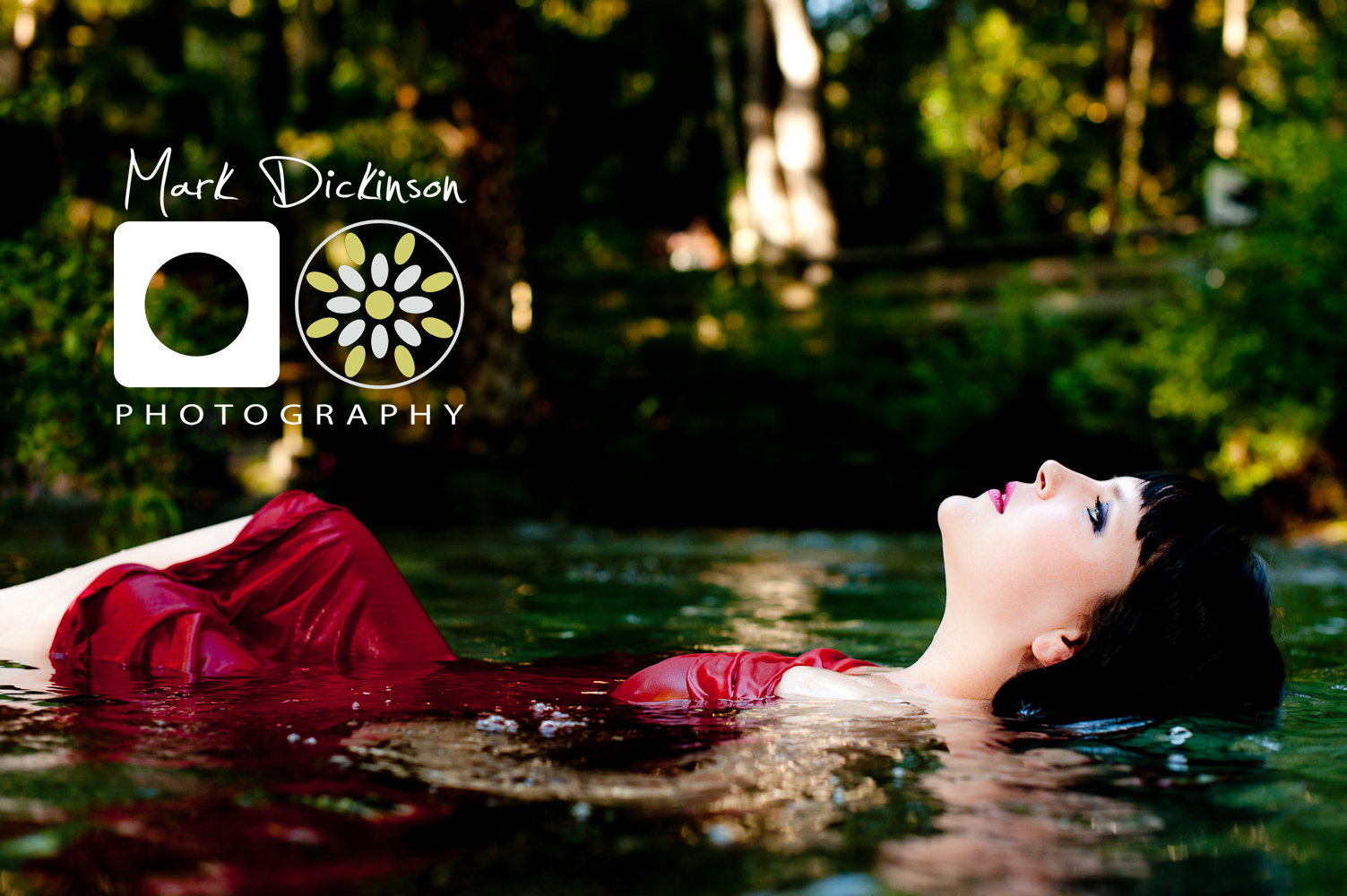 Mark Dickinson Photography | Girl with red dress in river floating